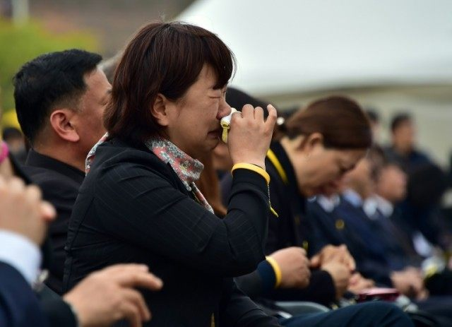 Relatives of the victims of the sunken South Korean ferry Sewol during the second anniversary memorial event in Ansan, the victims' home city, on April 16, 2016