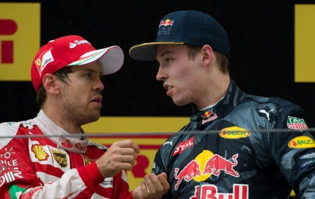 "Sebastian Vettel (L) was second in the Chinese Grand Prix followed in third place by Red Bull's Daniil Kvyat, who the Ferrari driver called ""a madman"" after a first-corner clash during the race in Shanghai on April 17, 2016"
