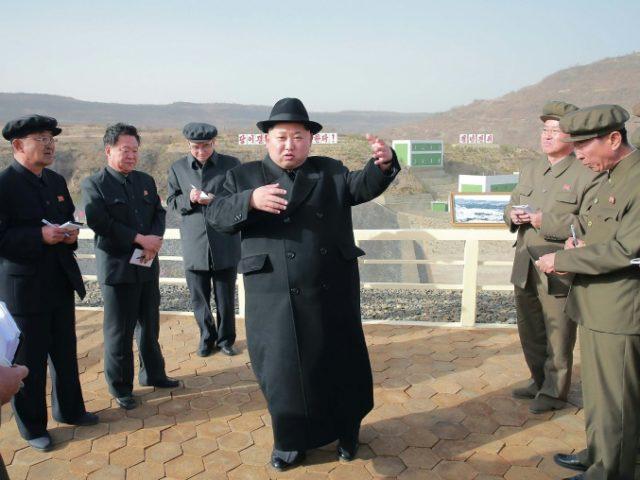 North Korean leader Kim Jong-Un (C), seen during a visit to the Paektusan Hero Youth Power Station No. 3 in Ryanggang Province