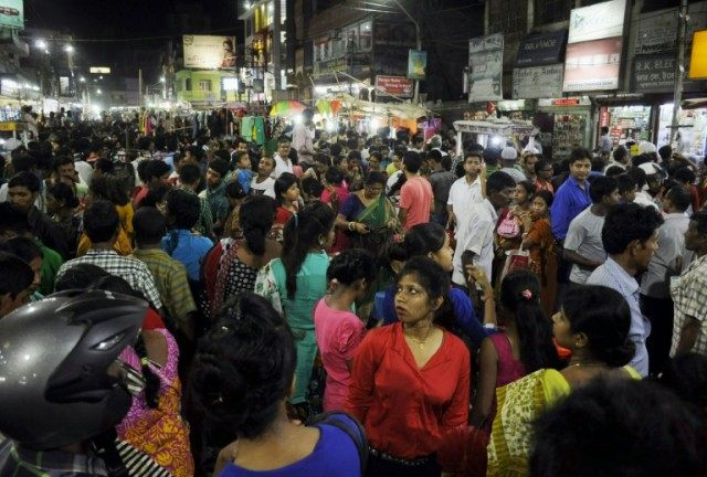 People crowd onto the street during an earthquake in Agartala, capital of India's northeastern state of Tripura, on April 13, 2016