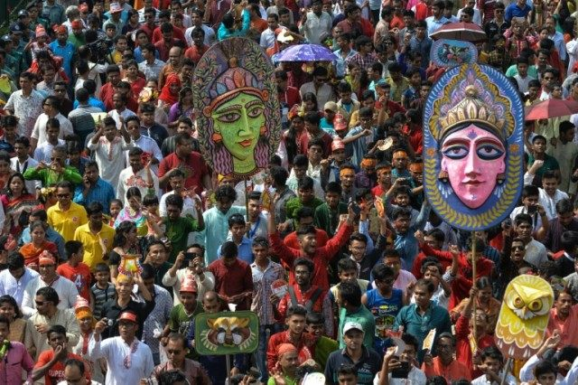 Revellers attend a rally in celebration of the Bengali New Year in Dhaka, on April 14, 2016