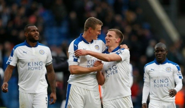 Leicester City's Robert Huth (L) celebrates with Marc Albrighton (R) after a 1-0 victory in the English Premier League match against Crystal Palace at Selhurst Park in south London on March 19, 2016