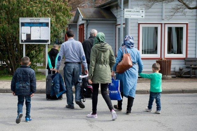 Refugees from Syria arrive at the Friedland shelter near Goettingen, central Germany, on April 4, 2016
