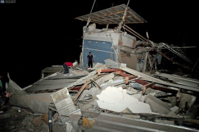 Residents survey destroyed housing in Guayaquil, Ecuador after a strong 7.8-magnitude earthquake