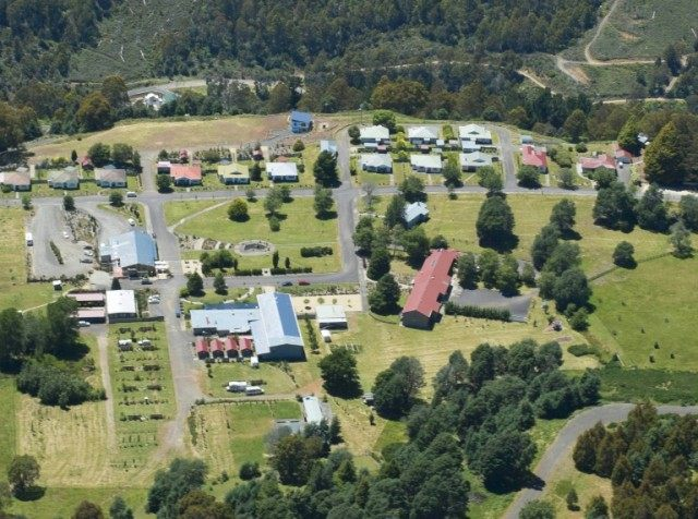 An arial view of Tarraleah village in Tasmania, which has been listed for sale, attracting interest from China and Singapore