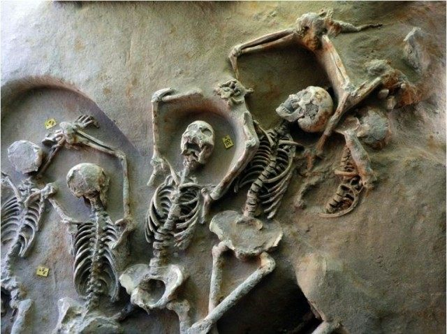 The remains of men buried in a mass grave found in an area of the Falirikon Delta in South Athens