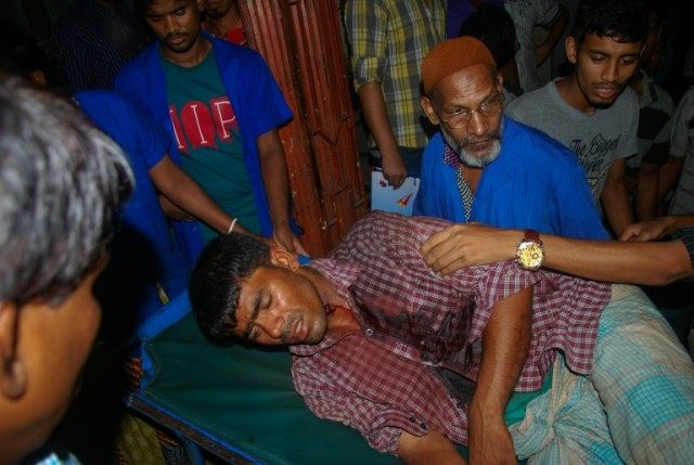 An injured Bangladeshi man is carried on a stretcher at Chittagong hospital on April 4, 2016 after police opened fire at hundreds of villagers in a remote coastal town in Bangladesh's southeast