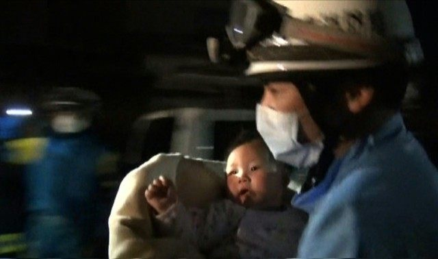 Japanese rescuers pulled the eight-month old girl from the rubble of a house in Mashiki, on April 15, 2016