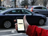 Uber agreed to pay up to $100 million to settle lawsuits from drivers in California and Massachusetts