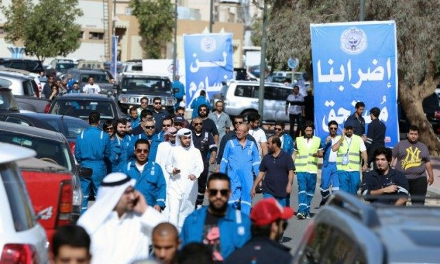 Kuwaiti oil workers arrive at their union headquarter in Al-Ahmadi, 35 km south of Kuwait city, on April 17, 2016, to protest against plans to cut their wages and privatise parts of the oil sector