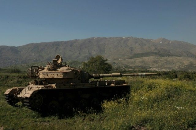 The wreckage of a tank in the Israeli-occupied sector of the Golan Heights, along the border with Syria