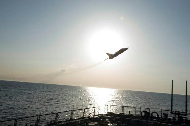 A Russian Sukhoi Su-24 attack aircraft makes a very-low altitude pass by the USS Donald Cook operating in the Baltic Sea