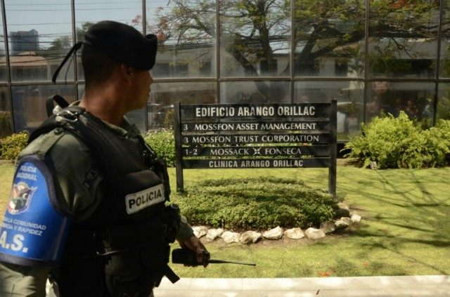 A policeman stands guard outside Mossack Fonseca, the Panamanian law firm whose leaked Panama Papers revealed how the world's wealthy and powerful used offshore companies to stash assets