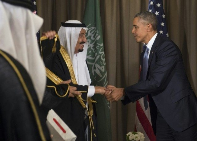 US President Barack Obama (L) shakes hands with Saudi King Salman bin Abdulaziz Al Saud following a meeting on the sidelines of the G20 summit in Antalya, Turkey on November 15, 2015