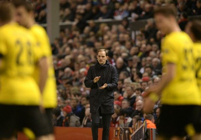 Dortmund's head coach Thomas Tuchel (C) congratulates his team after they scored their third goal against Liverpool, during the UEFA Europa league quarter-final second leg at Anfield on April 14, 2016