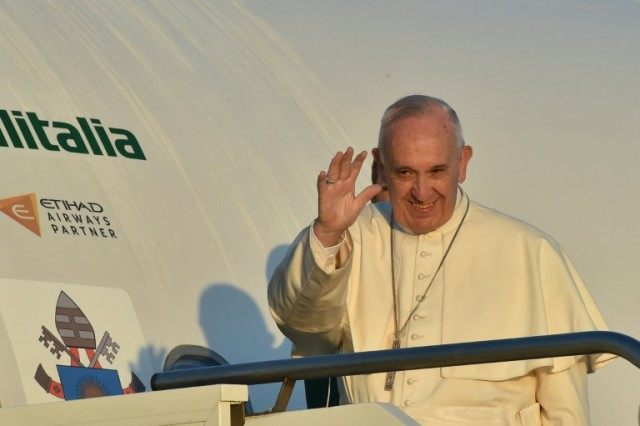 Pope Francis arrived at Lesbos airport for a five-hour visit during which he will spend time with refugees alongside Orthodox Patriarch Bartholomew