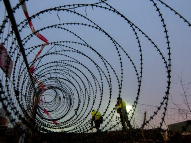 A barbed wire fence is erected at a border crossing between Austria and Slovenia at Spielfeld, Austria in December 2015