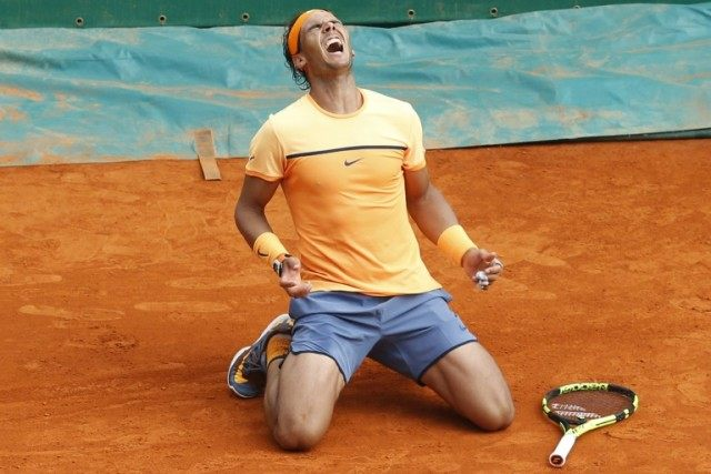 Spain's Rafael Nadal celebrates a record ninth title at the Monte Carlo Open after defeating in three sets France's Gael Monfils in Monaco on April 17, 2016
