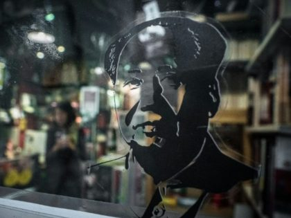 A sticker depicting Chairman Mao Zedong is seen on the door of a book store selling magazines about Chinese politics in Causeway Bay, Hong Kong