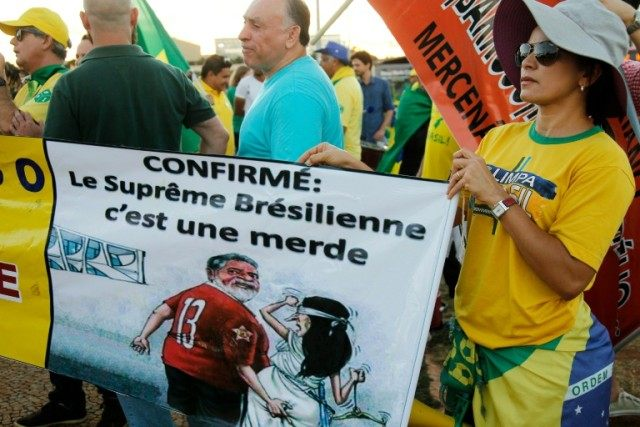 People supporting the impeachment of President Dilma Rousseff demonstrate in front of the Supreme Court in Brasilia
