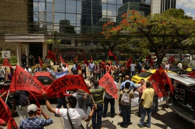 Members of the Construction Workers Union demonstrate outside Mossack Fonseca headquarters at Panama city on April 13, 2016