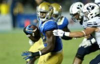 Linebacker Myles Jack (L) of the UCLA Bruins, ranked one of the five best players in the draft by NFLDraftScout.com, missed most of last season at UCLA after undergoing knee surgery