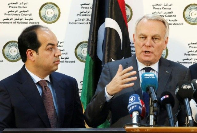 Libyan deputy prime minister of the UN-backed government Ahmed Maiteeq (L) looks on as French Foreign Affairs Minister Jean-Marc Ayrault speaks during a press conference at the naval base in the Libyan capital, Tripoli on April 16, 2016