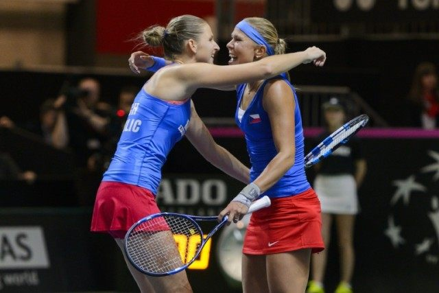 Czech tennis players Karolina Pliskova (L) and Lucie Hradeck celebrate after defeating Switzerland on April 17, 2016