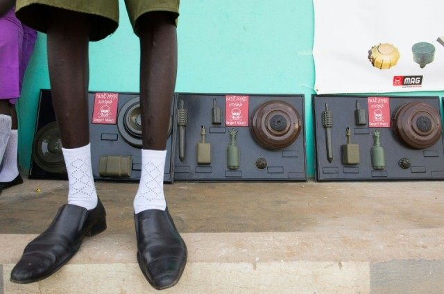 A student stands in front of a cast of landmines in Juba during a mine awareness intiative in schools in South Sudan