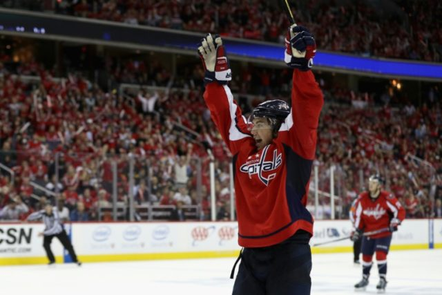 T.J. Oshie of the Washington Capitals celebrates after scoring the game winning goal against the Pittsburgh Penguins in Game One of the Eastern Conference Second Round