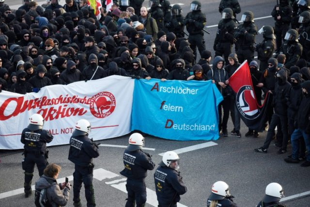 "Protesters try to block access to the party congress of right-wing populist party ""Alternative Fuer Deutschland"" (Alternative for Germany) in Stuttgart on April 30, 2016"
