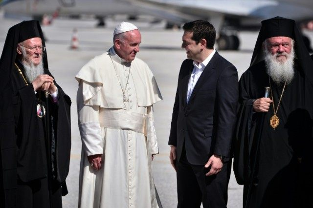Pope Francis (2nd-L) meets Greek Prime Minister Alexis Tsipras (2nd-R), arriving on the Greek island of Lesbos on April 16, 2016