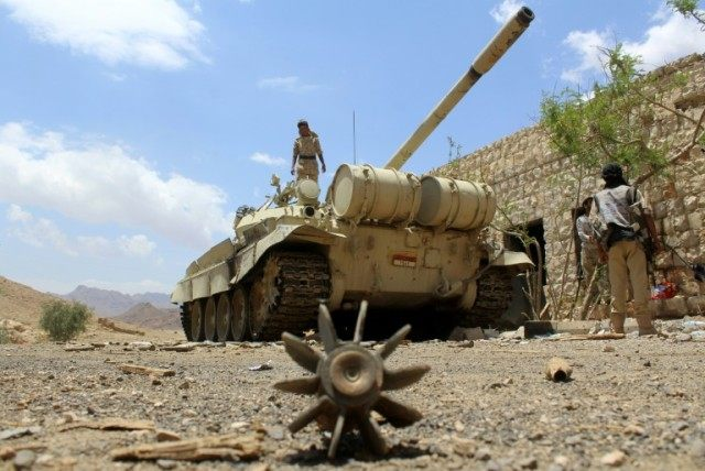 Yemeni pro-government forces hold a position east of the Yemeni capital