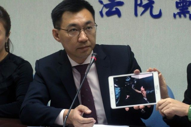 Johnny Chiang, a legislator from the Kuomintang (KMT) party, shows a video of Taiwanese citizens detained at a police station in Kenya, in Taipei, April 12, 2016