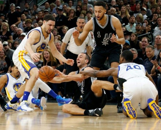 San Antonio Spurs' Manu Ginobili go for a loose ball during the game against the Golden State Warriors at AT&T Center on April 10, 2016