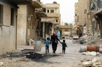 Syrians inspect their homes upon their return to the modern town of Palmyra, adjacent to the ancient Syrian city, on April 9, 2016