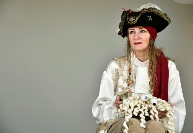 Karen Martyn from the Church of the Flying Spaghetti Monster poses in the pirate outfit that she will wear at the church's first legally recognised wedding to be held on April 16 in Wellington
