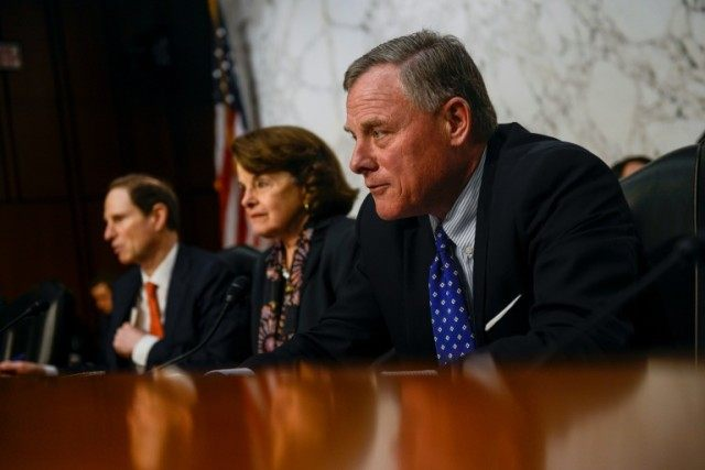 Senators Richard Burr (R) and Dianne Feinstein (C) of the Senate Intelligence Committee, pictured on February 9, 2016, unveiled legislation to require technology firms to help law enforcement unlock encrypted devices