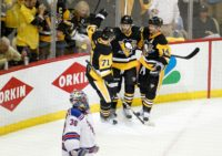 Bryan Rust #17 of the Pittsburgh Penguins celebrates after scoring his second goal in Game Five of the Eastern Conference First Round against the New York Rangers during the 2016 NHL Stanley Cup Playoffs at Consol Energy Center on April 23, 2016