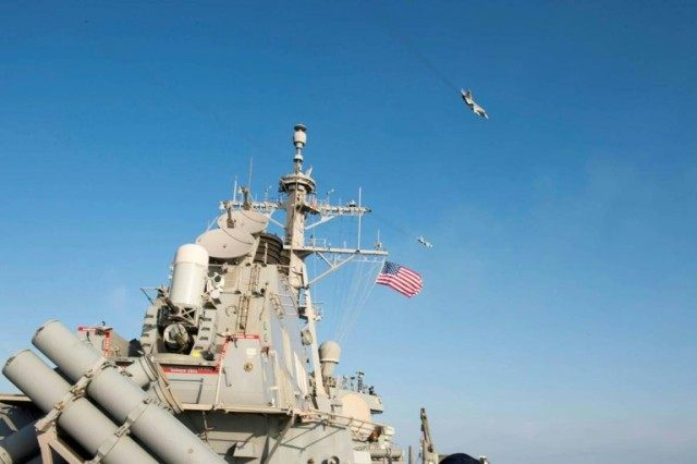 Two Russian Sukhoi Su-24 attack aircraft fly over the USS Donald Cook, operating in the Baltic Sea April 12, 2016