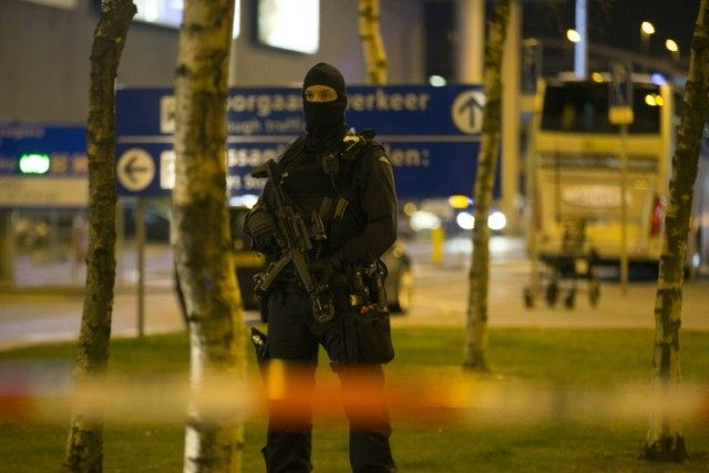 A Dutch policeman stands guard by a cordoned off area outside Amsterdam's Schiphol Airport late on April 12, 2016