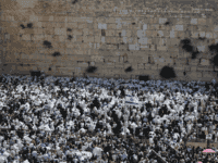 Jewish men, draped in prayer shawls, take part in the Cohanim prayer (priest's blessing) during the Pesach (Passover) holiday at the Western Wall in the Old City of Jerusalem on April 25, 2016.