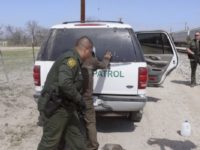 NBC NEWS -- Pictured: Border Patrol Agents arrest 8 suspected illegals and read them their Miranda Rights in Maverick County, near Eagle Pass, TX, as they try to ride a freight train into the United States on February 27, 2007 -- Photo by: Al Henkel/NBC NewsWire