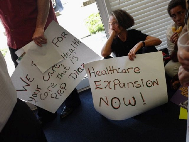 MIAMI, FL - SEPTEMBER 20: Deborah Dion and other protesters gather in the office of Florida State Rep. Manny Diaz as they protest his stance against the expansion of healthcare coverage on September 20, 2013 in Miami, Florida. As the protest took place, the Republican led House in Washington, D.C. …