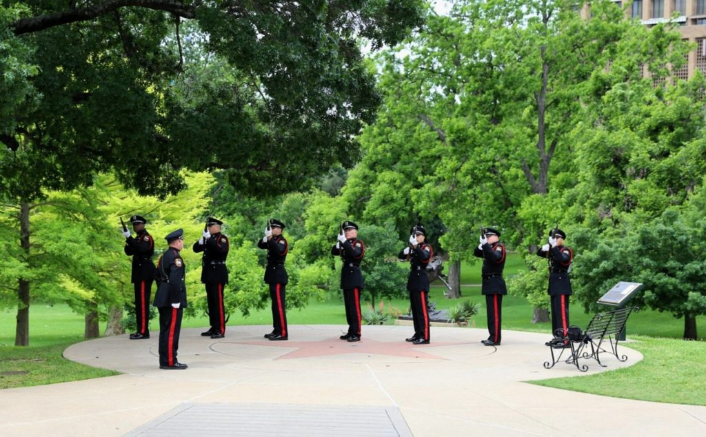 Officers render a twenty-one gun salute in memory of fallen brothers. (Photo: Texas Municipal Police Association)