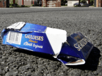 Lille, FRANCE: A crushed Gauloises cigarette packet lays before the Franco-Spanish Altadis fatory in Lille 31 August 2005 as the factory stops producing the legendary cigarettes, bringing to an end almost a century of history.