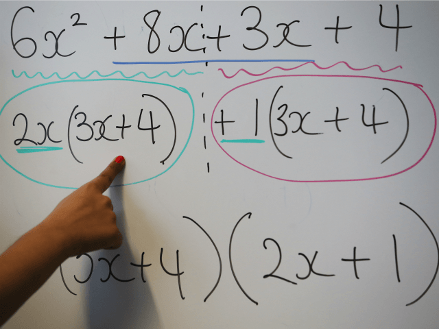 LONDON, ENGLAND - DECEMBER 01: A teacher writes an equation on a whiteboard during a maths lesson at a secondary school on December 1, 2014 in London, England. Education funding is expected to be an issue in the general election in 2015.