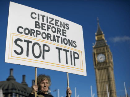 A woman demonstrates in central London on October 11, 2014, against the proposed Transatlantic Trade and Investment Partnership (TTIP).