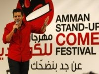 Dean Obeidallah an Arab-American/Italian-American producer and comedian performs at the Amman Stand-Up Comedy Festival in Amman-Jordan, Wednesday night Dec. 9, 2009.  (AP Photo/Mohammad Abu Ghosh)
