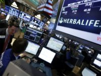 Thursday, Feb. 28, 2013, file photo, a pair of specialists confer at the post that handles Herbalife on the floor of the New York Stock Exchange. Herbalife, the seller of supplements and weight-loss products currently under federal investigation as a potential pyramid scheme, announced Thursday, March 3, 2016, that it …